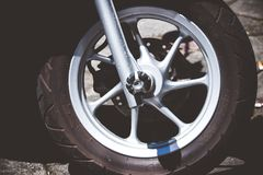 Silver Motorcycle Rim and Tire royalty free stock photo
