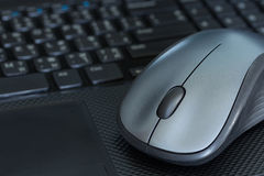 Silver mouse. On black laptop. It's a working equipment in nowaday Stock Photo