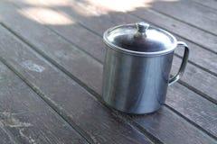 Silver mug on the table, version 1 stock photos