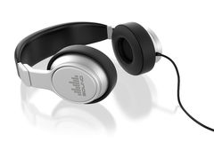Silver musical headphones. Stock Photos