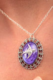 Silver Necklace bird purple gem Royalty Free Stock Photo