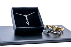 Silver necklace in a box and two beautiful watches Stock Image