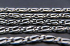 Silver necklace, Chain, Gold or stainless steel - On black background stock image