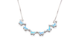 Silver necklace decorated by turquoise in islamic symbol shape Stock Photography