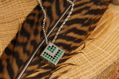 Silver necklace with emerald Stock Photos