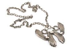 Silver necklace with foot pendant Stock Image