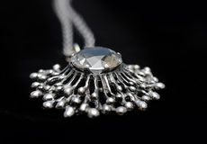 Silver necklace with gem stone royalty free stock photography