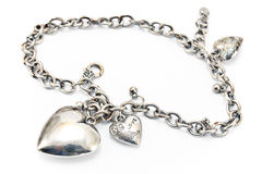 Silver necklace  with heart pendants Royalty Free Stock Photos