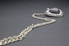 Silver necklace with heart-shaped pendant Stock Photography