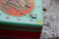 Silver necklace and a jewelry box Royalty Free Stock Images