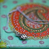 Silver necklace and a jewelry box Stock Photos