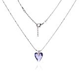 Silver necklace and pendant in the shape of heart Royalty Free Stock Photo
