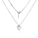Silver necklace and pendant in the shape of heart Stock Photography