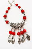 Silver necklace with red beads Royalty Free Stock Photo
