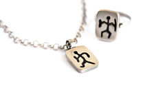 Silver necklace and ring stock images