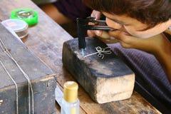 Silver Necklet Making. 9 April 2013: Silver workshop, Inlay Lake, Myanmar:  Burmese is making silver necklet at Silver workshop, Inlay lake, Myanmar Stock Image