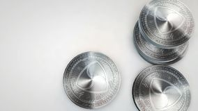 Silver nem coins falling on white background. Animation stock footage