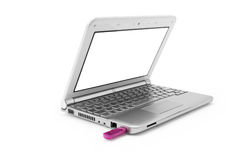 Silver netbook with pink usb Royalty Free Stock Image