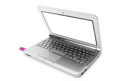 Silver netbook with pink usb Royalty Free Stock Photo