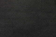 Silver netting. On a black background Royalty Free Stock Images