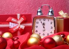 Silver New year clock with many balls on abstract background, Christmas decoration. Silver New year clock with many balls on abstract background.Christmas stock images