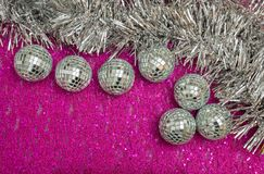 Silver New Year`s and Christmas decorations on the pink base. royalty free stock photo