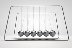 Silver Newton's Cradle Stock Photo