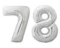 Silver number 78 seventy eight made of inflatable balloon isolated on white. Silver metallic number 78 seventy eight made of inflatable balloon isolated on white Royalty Free Stock Photo