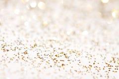 Silver och guld- gnistrandebakgrund Arkivfoton