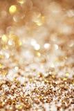 Silver och guld- gnistrandebakgrund Arkivbilder