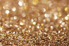 Silver och guld- gnistrandebakgrund Royaltyfri Fotografi