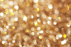 Silver och guld- gnistrandebakgrund Arkivfoto