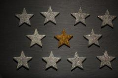 Silver och guld- stjärnor en Fotografering för Bildbyråer