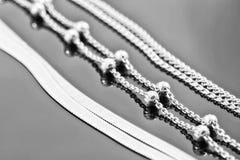 Silver- och guldkedjor Royaltyfri Fotografi