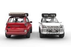 Silver och rödbruna stora moderna SUVs Arkivbild