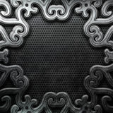 Silver ornamental plate. Silver plate with classic ornament on metal grid Royalty Free Stock Image