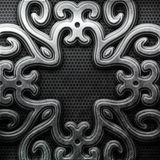 Silver ornamental plate. Silver plate with classic ornament on metal grid Royalty Free Stock Photo