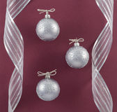 Silver Ornaments and Ribbon Stock Photography