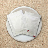 Silver package on white plate Royalty Free Stock Photos