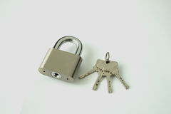 Silver padlock with keys. On white background Royalty Free Stock Photography