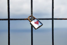 Silver padlock with a red heart Royalty Free Stock Images