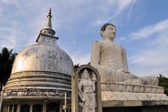 Silver Pagoda and buddha in Sri Lanka. Silver Pagoda and meditating buddha statue in Galle, Sri Lanka Royalty Free Stock Image