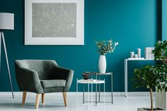 Silver painting in blue room stock photography