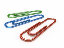 Silver paper clip. On white background Royalty Free Stock Photography
