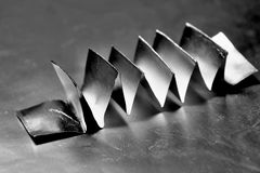 Silver. Paper on a shiny background folded and creased Stock Photo