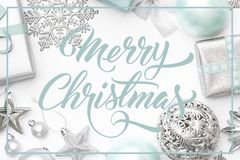 Silver and pastel blue christmas gifts, ornaments and decorations isolated on white background. Christmas border. Silver and pastel blue christmas gifts royalty free stock photos