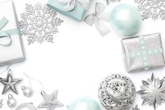 Silver and pastel blue christmas gifts, ornaments and decorations isolated on white background. Wrapped xmas boxes, christmas ornaments and baubles. Christmas stock photo