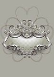 Silver pattern with heraldry and spirals on a silver frame Royalty Free Stock Images