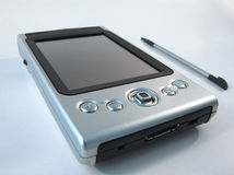 Silver PDA. Satin silver PDA and stylus Royalty Free Stock Photography