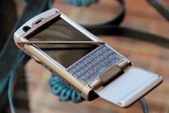 Silver pda phone Royalty Free Stock Photo